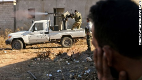 Rebels from the Free Syrian Army fire against ISIS on the outskirts of Dabiq on Saturday, one day before they seized the city from the terror group.