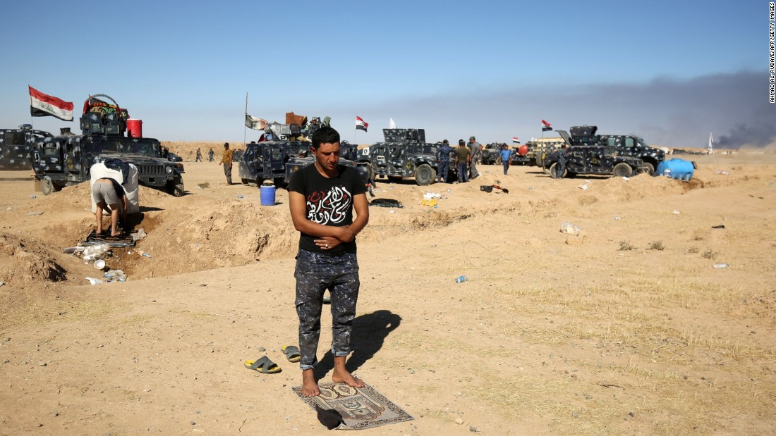 A Sunni Iraqi police officer prays at the Qayyara airbase on October 16.