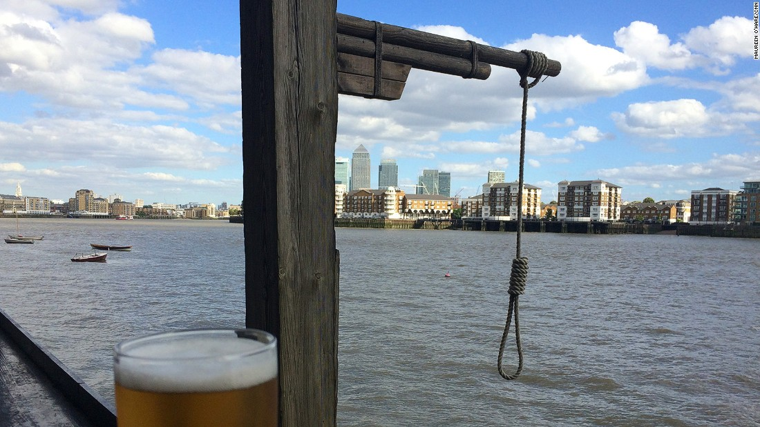 "At London's oldest riverside pub, <a href=""http://www.taylor-walker.co.uk/pub/prospect-of-whitby-wapping/c8166/"" target=""_blank"">The Prospect of Whitby</a>, customers can sip a pint on the Thameside balcony under the shadow of a replica gallows that commemorates Execution Dock, which once stood in this area."