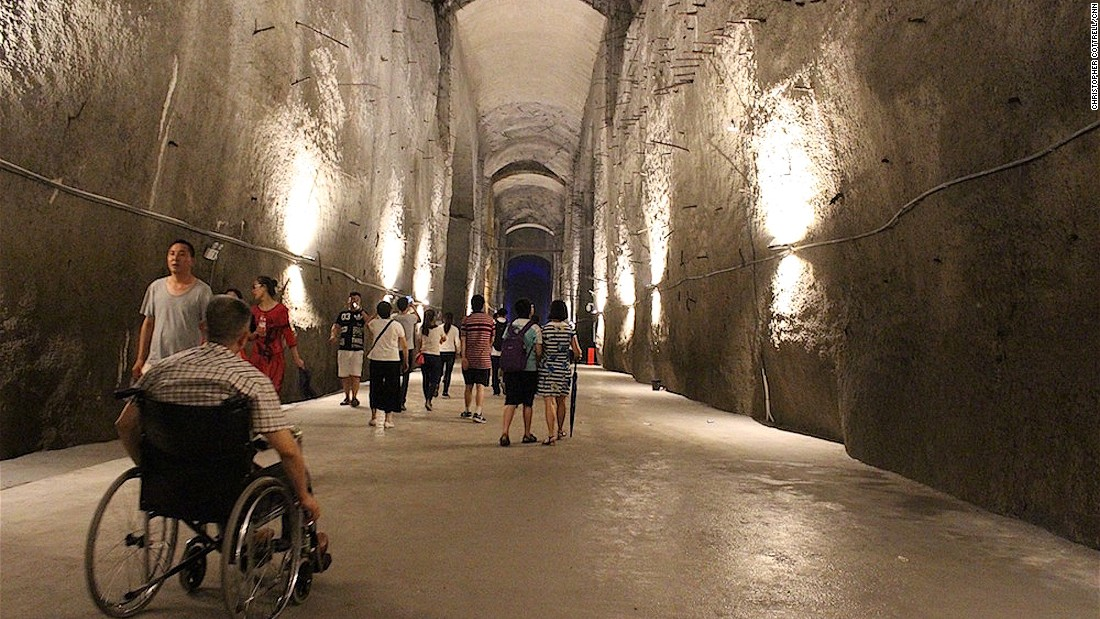Final halls in the plant resemble gigantic mine tunnels with 200-foot ceilings cut out of rock and lit with white lights.