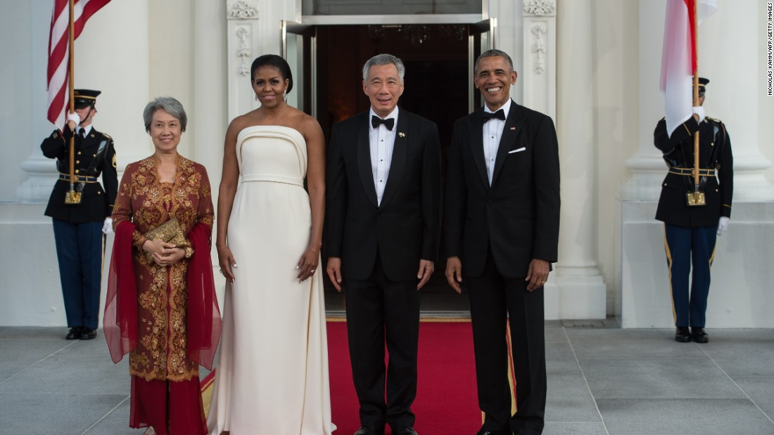 President Barack Obama and first lady Michelle Obama greet Singapore's Prime Minister Lee Hsien Loong and his wife, Ho Ching, for a state dinner at the White House on August 2, 2016.