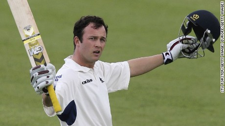 BIRMINGHAM, UNITED KINGDOM-APRIL 28: Warwickshire batsman Jonathan Trott raises his bat after reaching his century during the third day of the Liverpool and Victoria Cricket County Championship Division One match between Warwickshire and Yorkshire at Edgbaston on April 28, 2006 in Birmingham, England.  (Photo by Stu Forster/Getty Images)