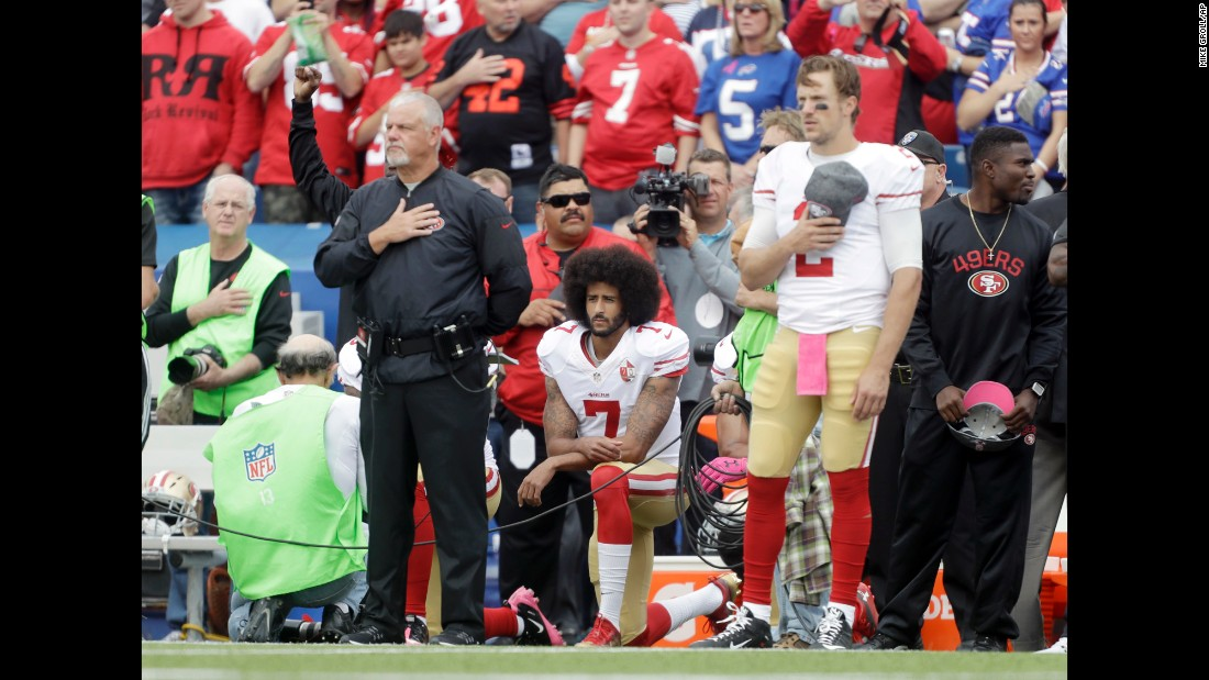 "San Francisco quarterback Colin Kaepernick kneels during the national anthem before an NFL game at Buffalo on Sunday, October 16. Kaepernick was <a href=""http://www.cnn.com/2016/10/15/sport/colin-kaepernick-starts-anthem-protest/"" target=""_blank"">starting his first game for the 49ers</a> since his protest began in August."
