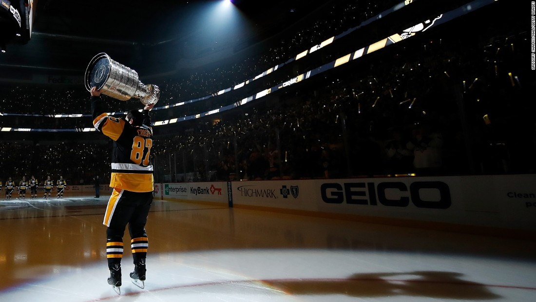 Pittsburgh captain Sidney Crosby skates with the Stanley Cup during pregame ceremonies on Thursday, October 13. The Penguins were raising their championship banner before the first home game of the new season.