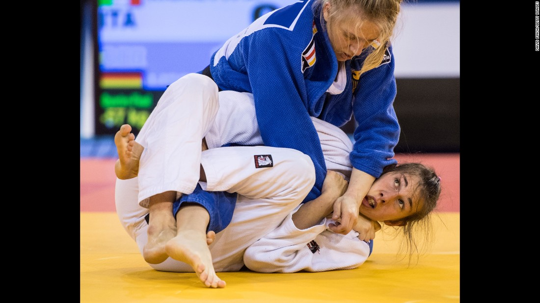 German judoka Jacqueline Lisson, in blue, tries to submit Italy's Anna Righetti during a tournament in Glasgow, Scotland, on Saturday, October 15.