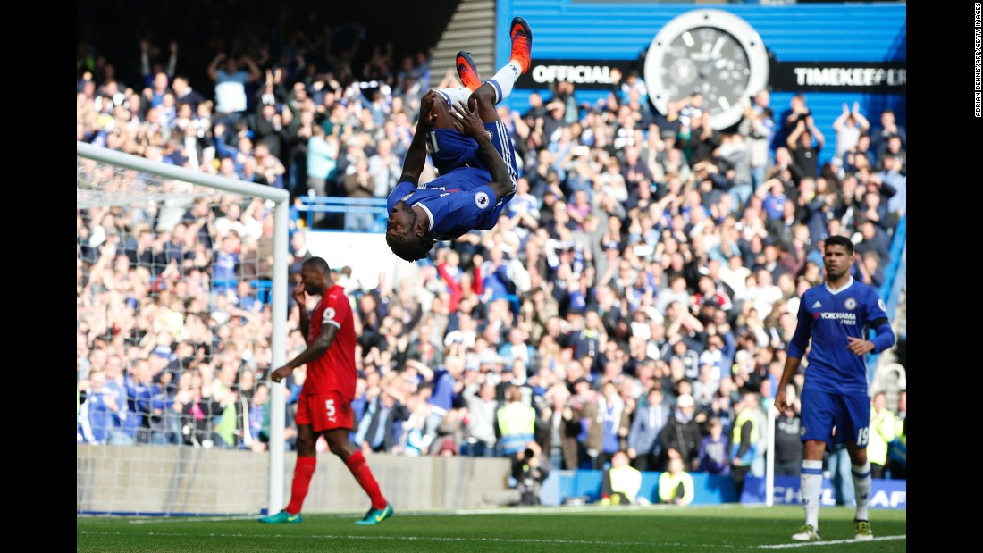 Chelsea midfielder Victor Moses flips after scoring a goal against Leicester City on Saturday, October 15. The match in London pitted the last two Premier League champions against each other. Chelsea won 3-0.