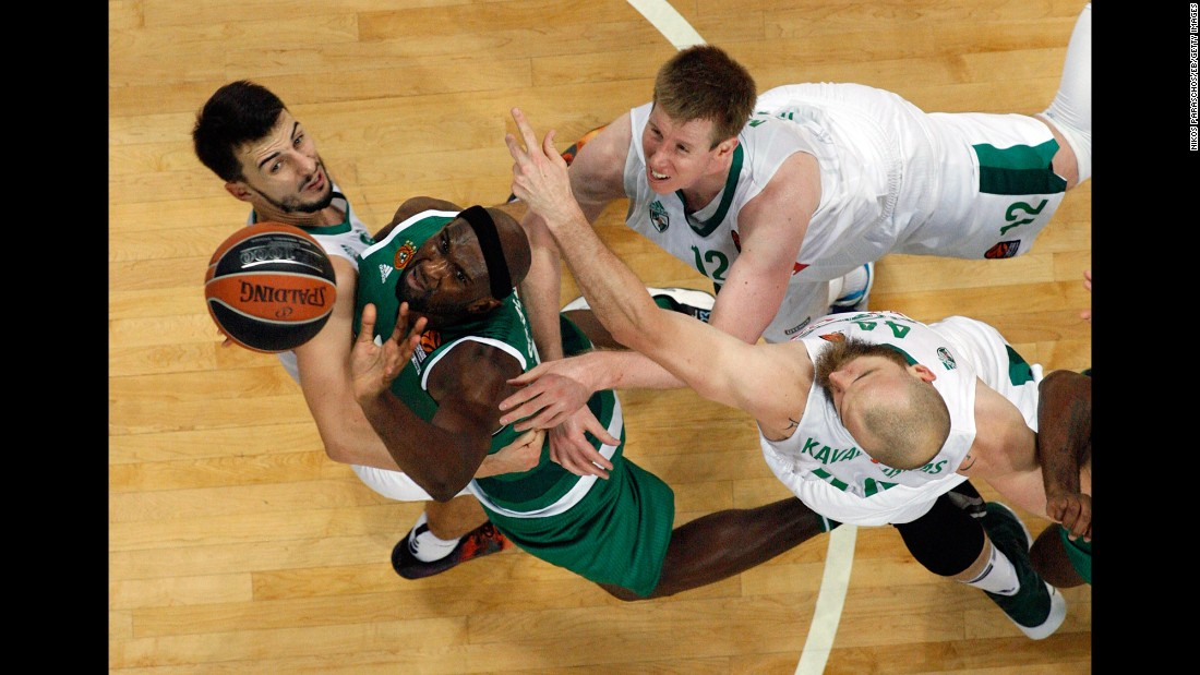 Panathinaikos forward Chris Singleton is surrounded by Zalgiris defenders during a EuroLeague game in Athens, Greece, on Friday, October 14.