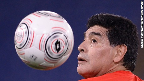 Argentinian football legend Diego Armando Maradona eyes the ball as he warms up ahead of the 'Match of Peace - United for Peace' charity football match promoted by the Schools for Encounter foundation at the Olympic stadium in Rome on October 12, 2016.  / AFP / FILIPPO MONTEFORTE        (Photo credit should read FILIPPO MONTEFORTE/AFP/Getty Images)
