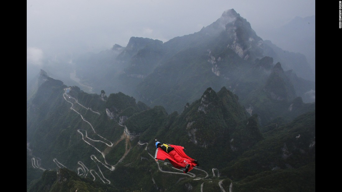 Gabriel Lott jumps off a mountain near Zhangjiajie, China, during the World Wingsuit Championship on Thursday, October 13.