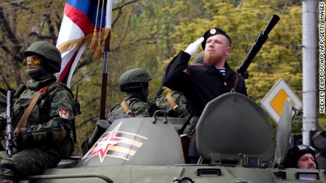 """A picture taken on May 9, 2016 in Donetsk shows pro-Russian rebel commander Arseny Pavlov, known as """"Motorola"""", saluting while taking part in a military parade marking the 71st anniversary of the victory over Nazi Germany in World War Two. Ukraine's pro-Russian rebels announced three days of mourning on October 17 after notorious rebel commander Arseny Pavlov, known as """"Motorola"""", was killed in a lift bombing. The 33-year-old Russian died late on October 16 when a homemade device exploded in the lift at the entrance to his block of flats in the de facto rebel capital Donetsk, separatist authorities said."""