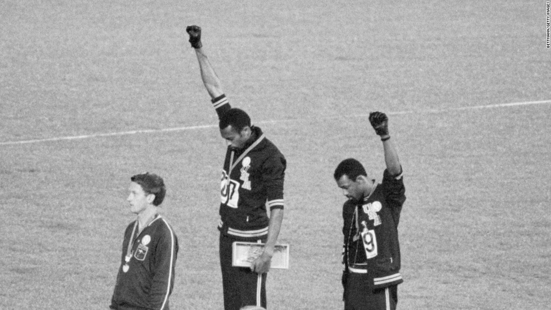 Tommie Smith and John Carlos, gold and bronze medalists in the 200-meter run at the 1968 Olympics, engage in a victory stand protest against unfair treatment of blacks in the United States. Both men paid a huge personal and professional price for their stand but are seen as heroes today.