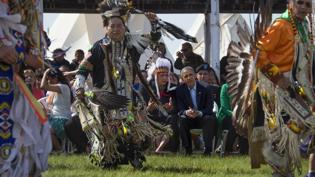 President Barack Obama talks with the chairman of the Standing Rock Sioux during a celebration in June 2014. Obama's brand of patriotism acknowledges misdeeds from America's past such as the nation's treatment of Native Americans, but Obama has aggressively reached out to them.