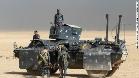 Iraqi forces hold a position on Monday in the area of al-Shurah, some 45 kilometers south of Mosul.