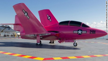 The pink paint job isn't permanent. Liquid dishwashing soap applied to the paint will allow it to be removed.