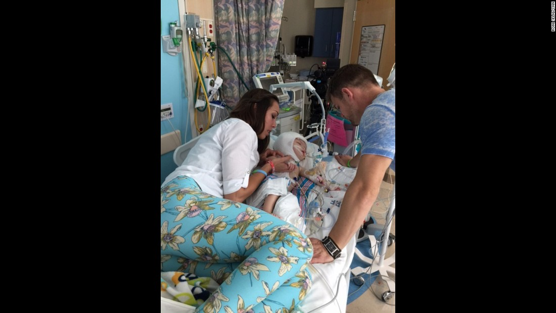 Nicole and her husband Christian McDonald spend time with Anias. At this point after the surgery, the boys were too fragile for Mom and Dad to pick them up.