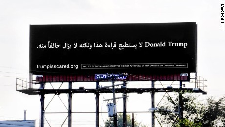 "A billboard in Dearborn, Michigan, reads ""Donald Trump can't read this, but he's afraid of it anyway"" in Arabic."