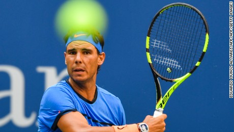 Rafael Nadal of Spain hits a return against Lucas Pouille of France during their US Open Men's Singles match at the USTA Billie Jean King National Tennis Center in New York on September 4, 2016. / AFP / EDUARDO MUNOZ ALVAREZ        (Photo credit should read EDUARDO MUNOZ ALVAREZ/AFP/Getty Images)
