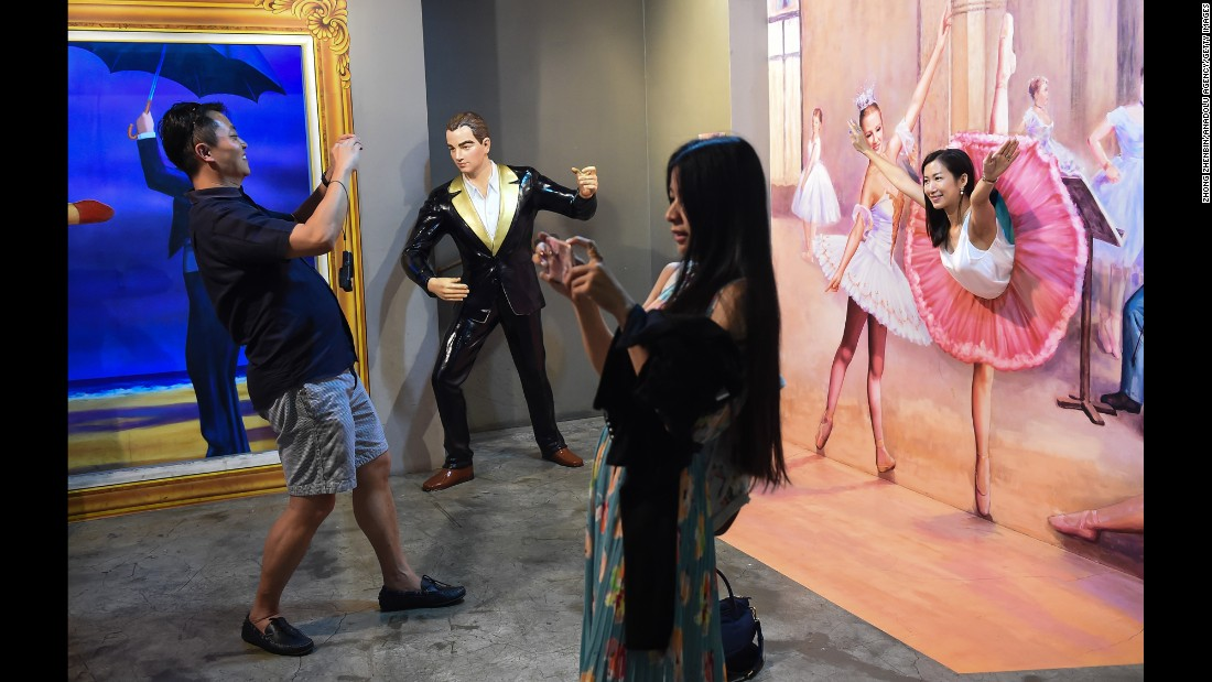 "Visitors fool around at Seoul's Trick Eye Museum, a gallery specializing in ""trompe l'oeil"" artworks. The museum opens until 9 p.m., making it a popular spot for dates and evenings out."