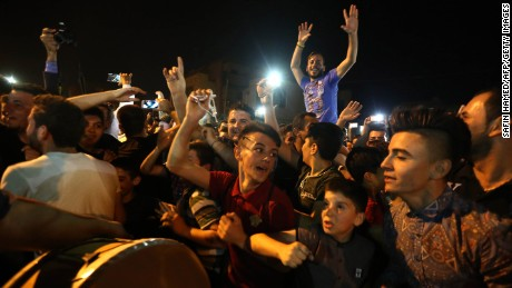 Displaced Christians from Qaraqosh celebrate in Irbil as Iraqi forces move in to free their hometown.