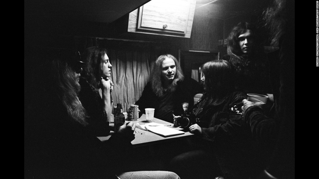 Members of the band party with friends in 1975.