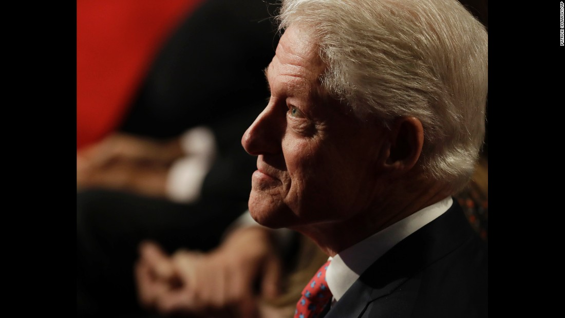 Bill Clinton waits for the third debate to start.