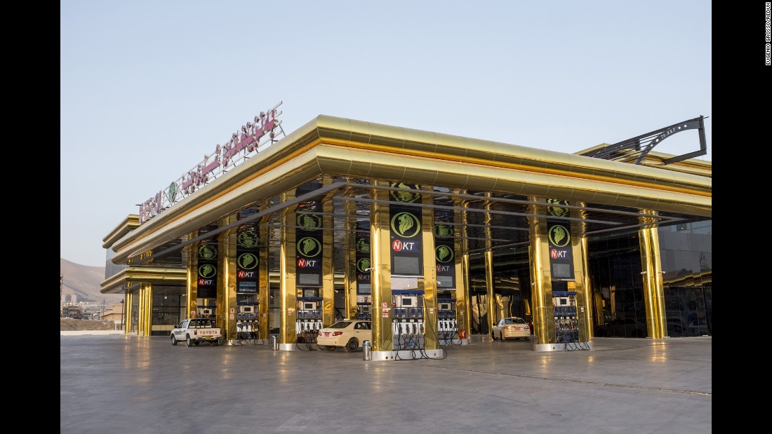 A gas station with an extravagant exterior.