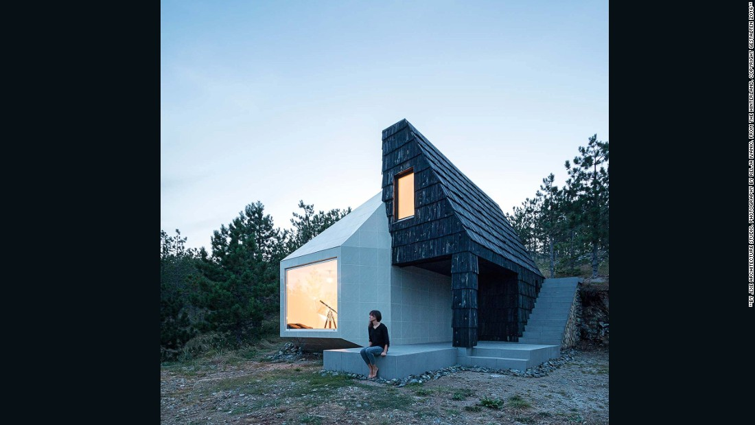 This cabin is a remodeled Serbian chalet, which has been adapted to include contemporary design elements. The base, walls, and roof of the original building are turned to its side, and then reworked to include a solar panel and a natural thermal wheel to make the structure ecologically friendly.
