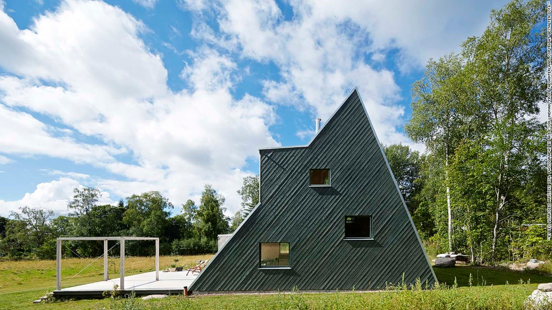 "This triangular structure is inspired by camping tents, according to the architect, Qvarsebo. ""I wanted to make the basic tent shape visible in my design, but with a sense of recreation,"" he says. This cabin features sloped walls for visitors to climb, and is divided into different sections, each for a different activity."