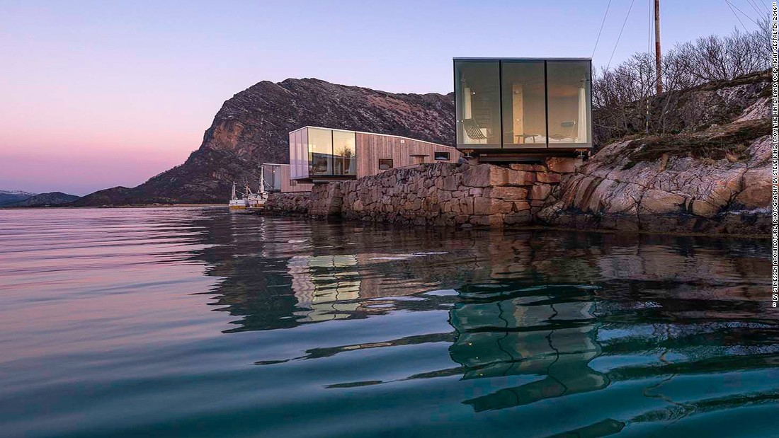 The cabins on this resort are made of angled glass and wood. The vast use of glass allows for increased access to natural light.