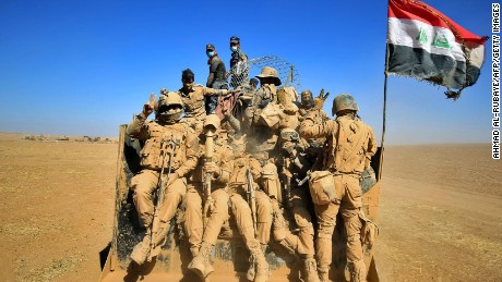 Iraqi forces sit in the back of a vehicle as troops advance through the desert on the banks of the Tigris river, northeast of the main staging base of Qayyarah, on October 20, 2016, during an operation against Islamic State (IS) group jihadists to retake the main hub city of Mosul. A wide array of Iraqi and international forces are involved in the fight to retake Mosul from the Islamic State jihadist group, which overran the country's second city in 2014. / AFP / AHMAD AL-RUBAYE        (Photo credit should read AHMAD AL-RUBAYE/AFP/Getty Images)