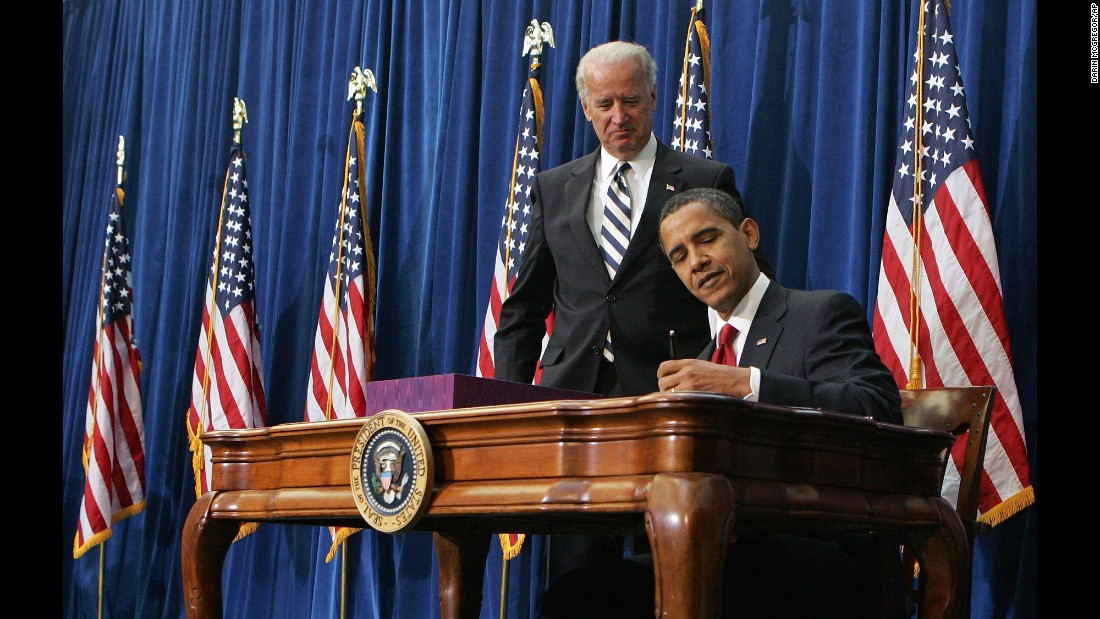 "Vice President Joe Biden watches Obama sign <a href=""http://www.cnn.com/2010/POLITICS/02/17/economic.stimulus.2010/"" target=""_blank"">the economic stimulus bill</a> on February 17, 2009. The goal was to stimulate the country's staggering economy by increasing federal spending and cutting taxes."