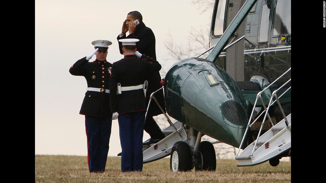 The President talks on a cell phone as he steps off Marine One in Baltimore on January 29, 2010.