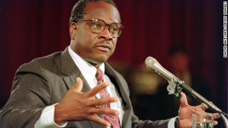 US Supreme Court nominee Clarence Thomas gestures, 10 September 1991, during confirmation hearings before the US Senate Judiciary Committee, in Washington D.C..