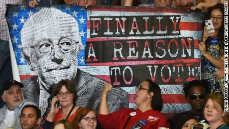 Supporters hold up a poster during a campaign rally by Bernie Sanders.