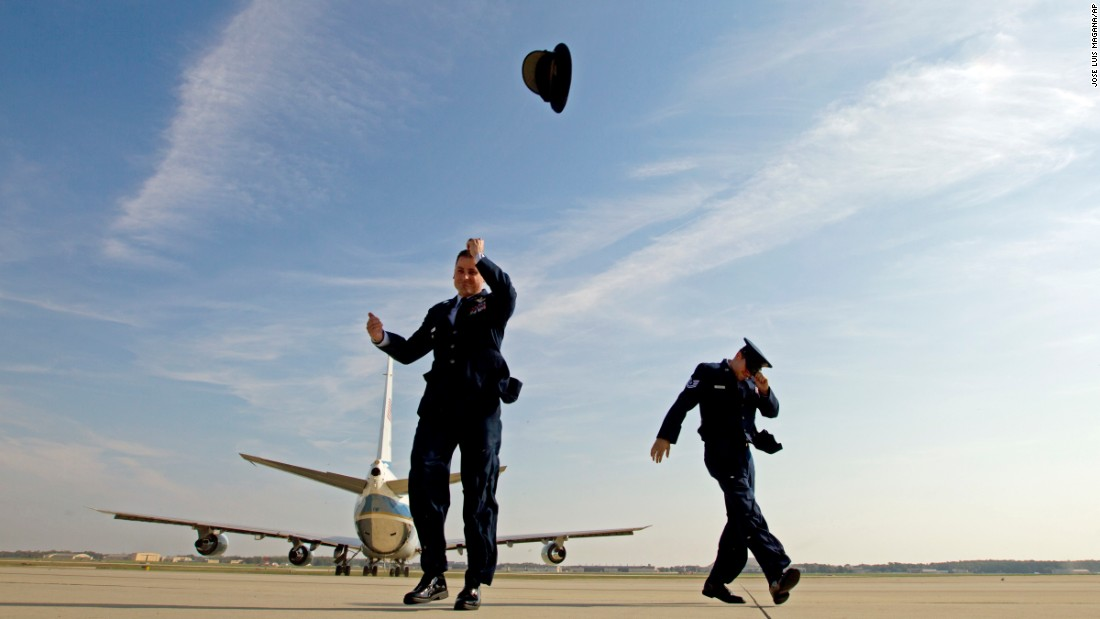 Air Force One knocks the hat off Air Force Col. Christopher M. Thompson as it leaves Andrews Air Force Base in Maryland on Thursday, October 20.