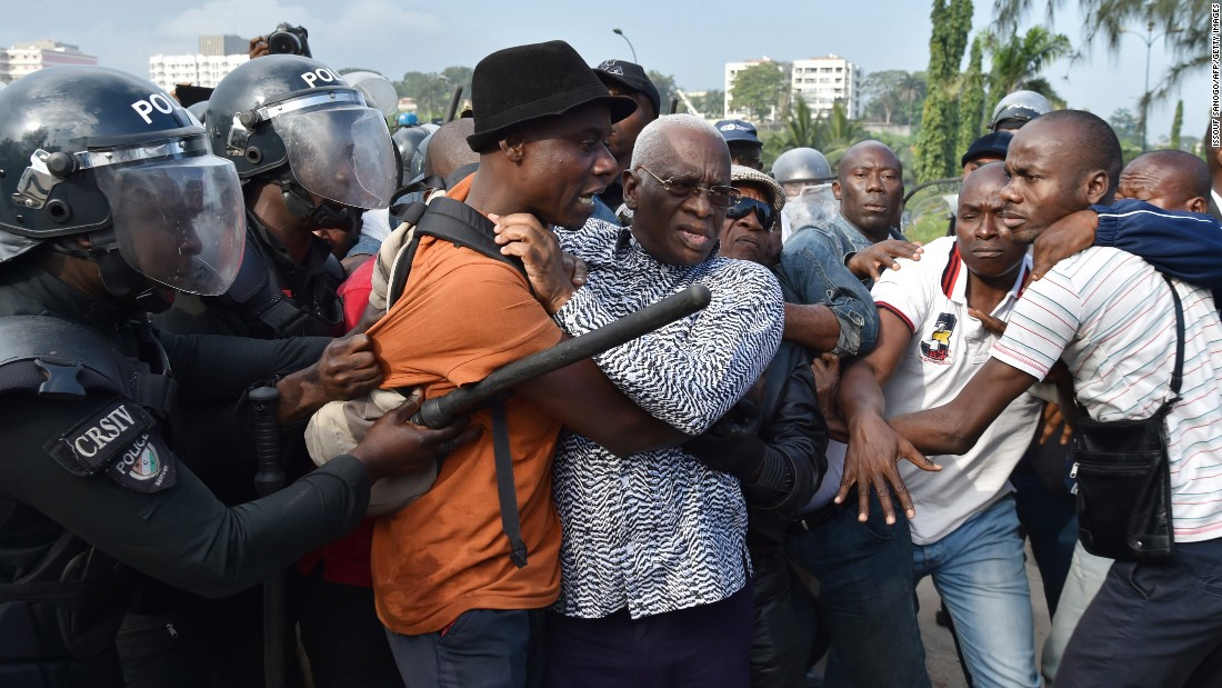 Police in Abidjan, Ivory Coast, arrest opposition leader Aboudramane Sangare, at center with the glasses, during a protest over a new proposed constitution on Thursday, October 20.