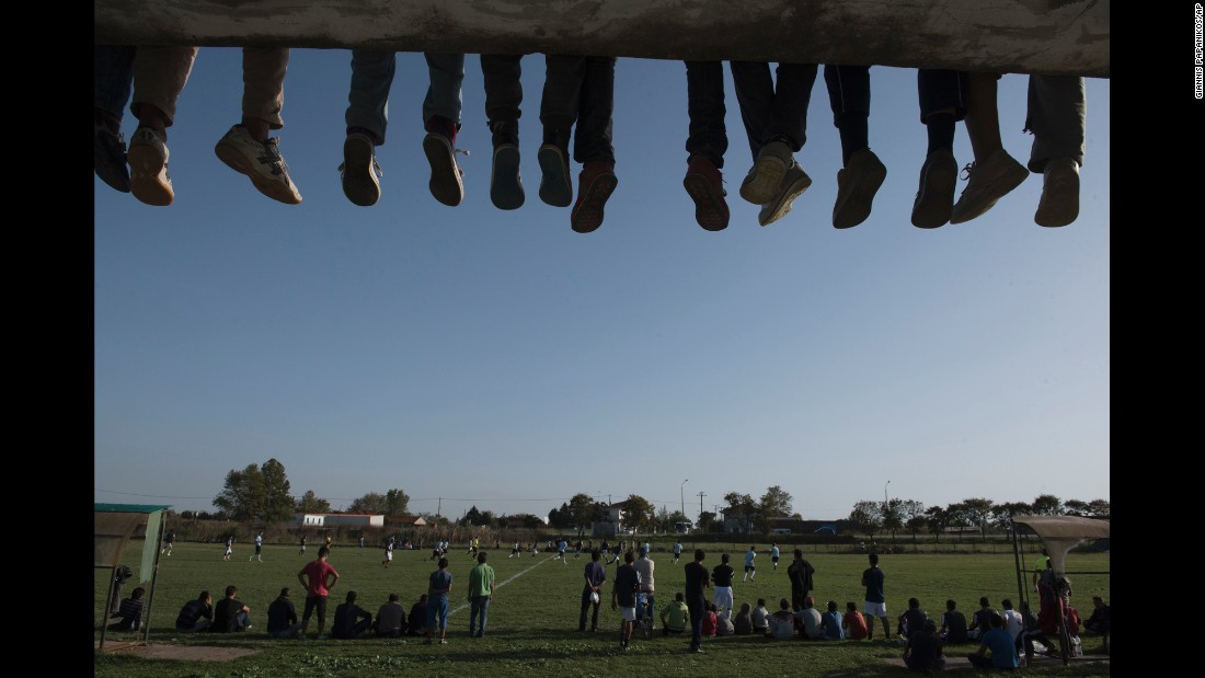 People watch a soccer match between refugee camps in northern Greece on Friday, October 14.