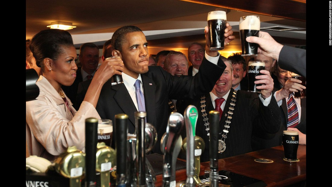 "Obama and the first lady enjoy a glass of Guinness as they <a href=""http://www.cnn.com/2011/POLITICS/05/23/obama.ireland/"" target=""_blank"">visit his ancestral home</a> of Moneygall, Ireland, on May 23, 2011. Moneygall is believed to be the birthplace of one of his great-great-great grandfathers."