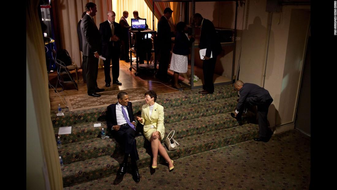 Obama talks backstage with Senior Advisor Valerie Jarrett before a reception in Philadelphia on June 30, 2011.