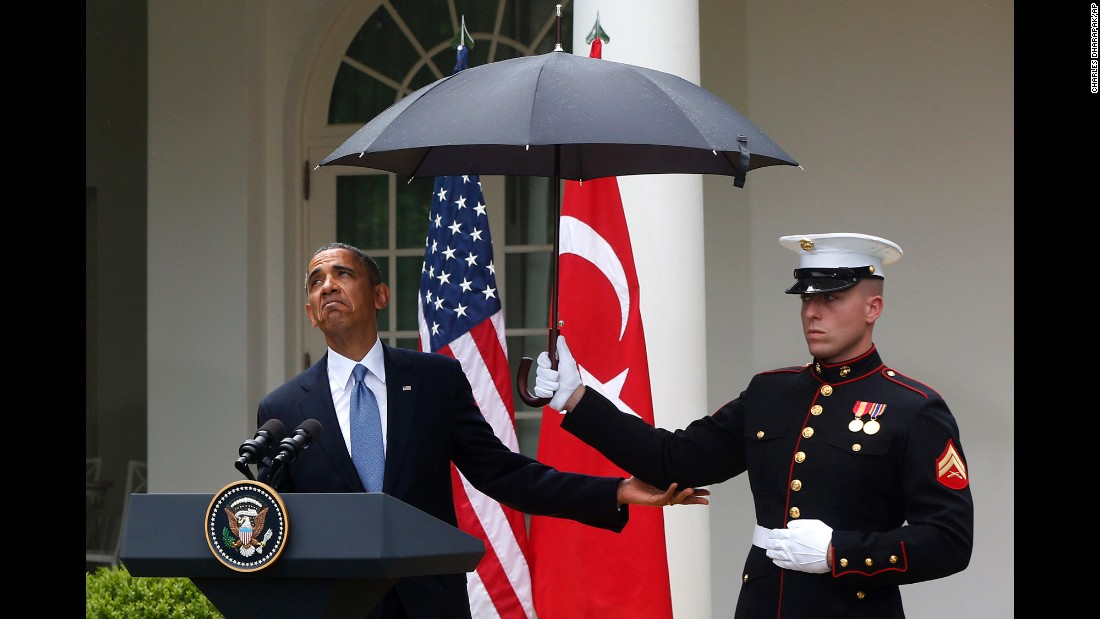 Obama looks to see if it's still raining at a White House news conference on May 16, 2013.