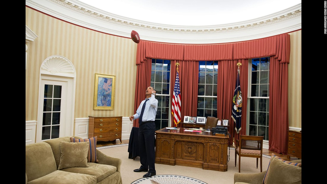 Obama tosses a football in the Oval Office on January 6, 2014.