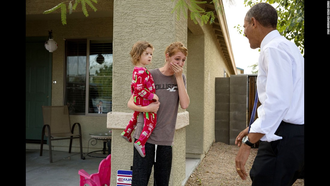 Obama greets locals in Phoenix after touring a model home of a nonprofit's housing development on January 8, 2014.