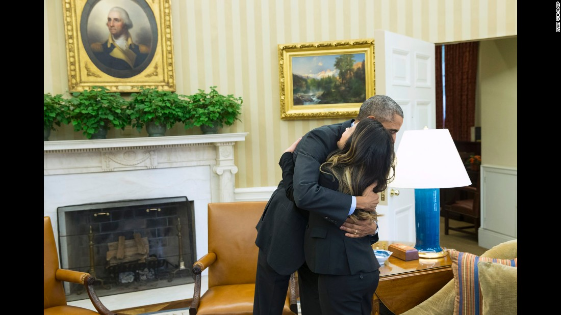 Obama hugs Ebola survivor Nina Pham in the Oval Office on October 24, 2014. Pham, one of two Dallas nurses diagnosed with the virus, was declared Ebola-free after being treated at a hospital in Bethesda, Maryland. The other nurse, Amber Vinson, was treated in Atlanta and also declared Ebola-free.