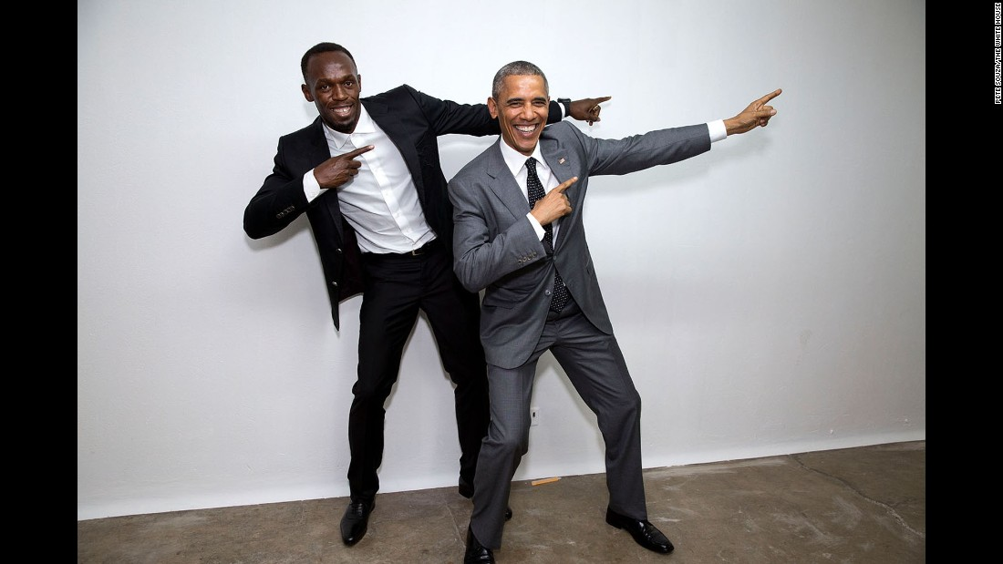 Obama poses with the world's fastest man, Jamaican sprinter Usain Bolt, at an event in Kingston, Jamaica, on April 9, 2015.