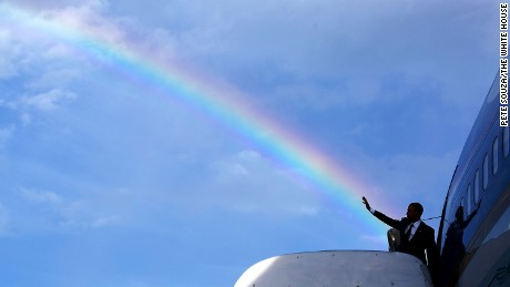 President Barack Obama's wave aligns with a rainbow as he boards Air Force One at Norman Manley International Airport prior to departure from Kingston, Jamaica, April 9, 2015. (Official White House Photo by Pete Souza)