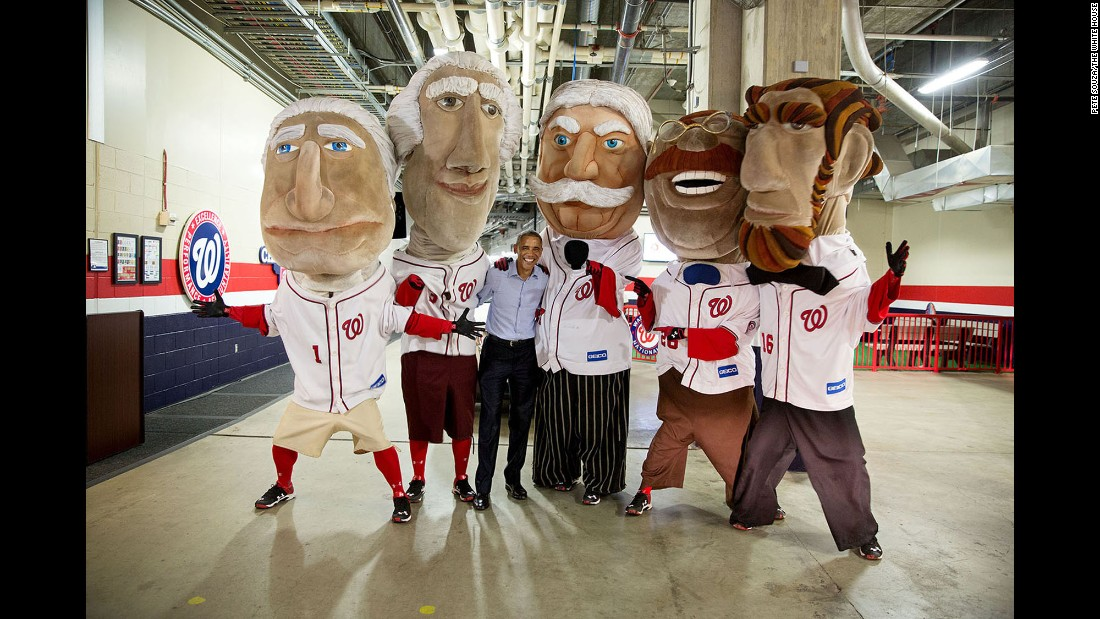"Obama takes a photo with the ""Racing Presidents"" of the Washington Nationals baseball team on June 11, 2015. The mascots, which race at every Nationals home game, represent former U.S. Presidents -- from left, George Washington, Thomas Jefferson, William Howard Taft, Theodore Roosevelt and Abraham Lincoln. ""The President asked the Secret Service to stop the motorcade when he spotted The Racing Presidents,"" White House Photographer Pete Souza said."