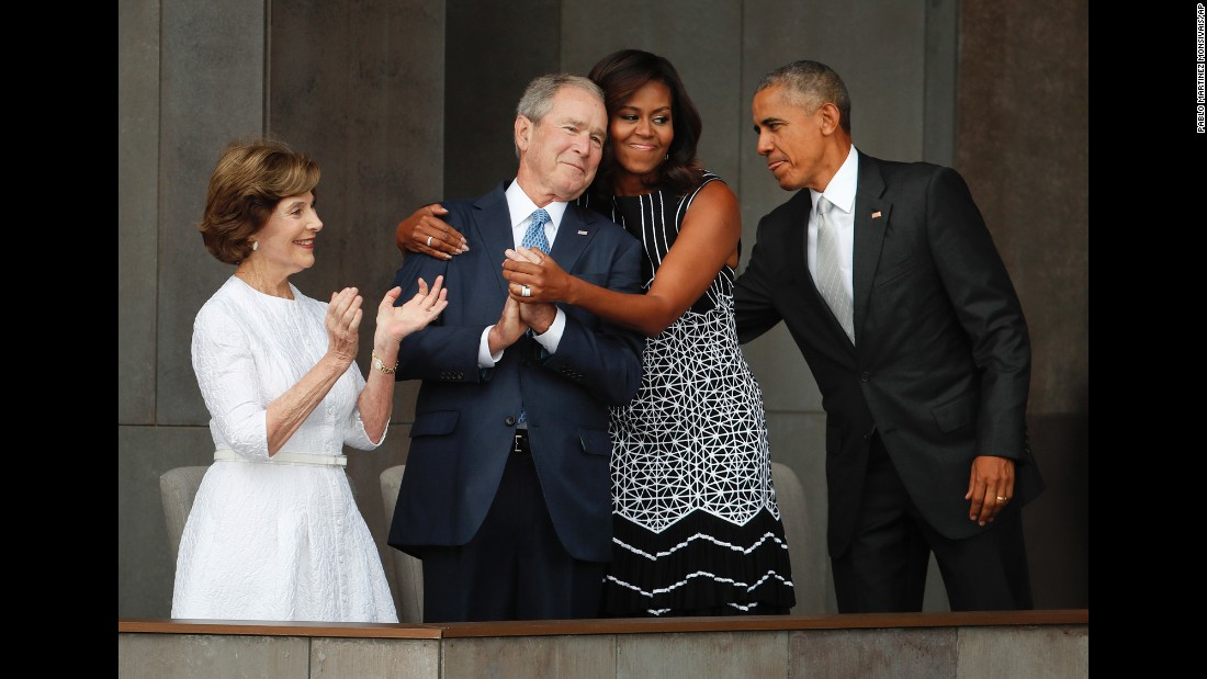 "First lady Michelle Obama hugs former U.S. President George W. Bush during <a href=""http://www.cnn.com/2016/09/23/politics/smithsonian-african-american-museum-obama/"" target=""_blank"">the dedication ceremony</a> of the new Smithsonian museum devoted to African-American history. The museum opened in Washington on September 24, 2016. <a href=""http://www.cnn.com/2016/09/24/politics/michelle-obama-george-w-bush-friendship/"" target=""_blank"">Read more: The friendship of Michelle Obama and George W. Bush</a>"