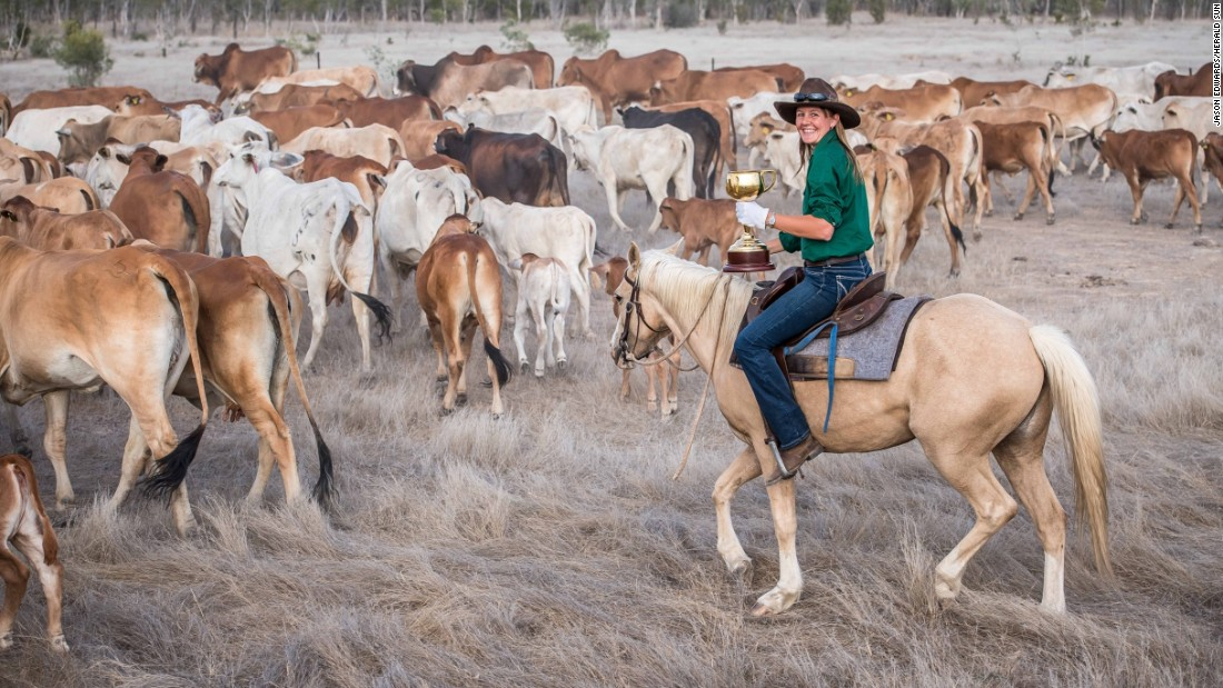 Jillaroo Kelly Smith musters the cattle at Table Top Station outside Croydon, Queensland.