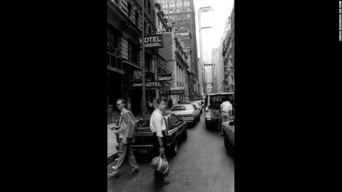 "Chris Isaac, center, and his manager, Mark Plummer, wait for a taxi in New York in 1985. ""I can still smell the stale beer and fresh piss wafting up from the sidewalk in the humidity,"" Zagaris said."