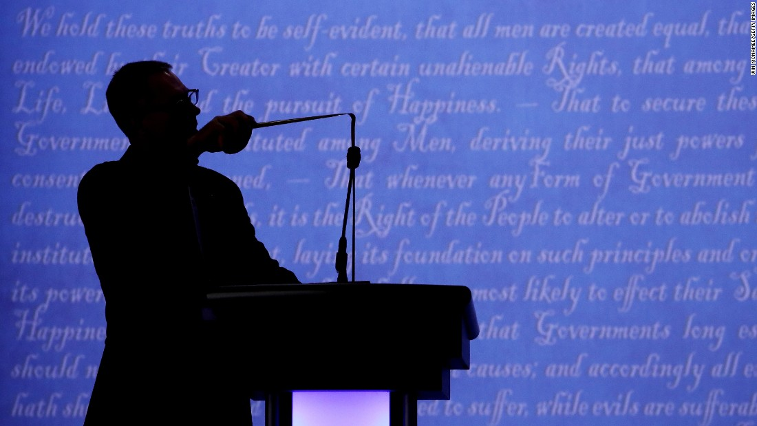 "A worker tests Donald Trump's microphone before the start of the presidential debate in Las Vegas on Wednesday, October 19. Trump <a href=""http://www.cnn.com/2016/09/27/politics/donald-trump-microphone-presidential-debate/"" target=""_blank"">complained about his microphone</a> after the first debate in September."